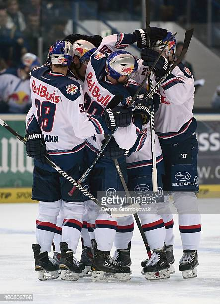 Toni Ritter of EHC Red Bull Muenchen celebrates as he scores their first goal during the DEL Ice Hockey match between Iserlohn Roosters and EHC Red...