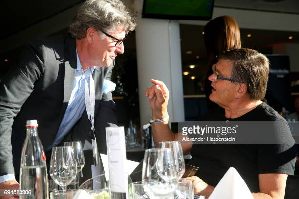 Toni Schumacher talks to Hans Meyer prior to the FIFA 2018 World Cup Qualifier between Germany and San Marino at on June 10 2017 in Nuremberg Bavaria