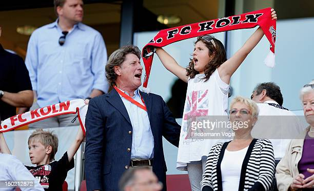 Toni Schumacher vicepresident of Cologne sings the club anthem with his daughter during PreSeason Friendly game between FC Cologne and FC Arsenal at...