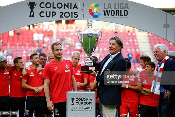 Toni Schumacher vicepresident of Kolen hands out the winning trophy to captain Matthias Lehmann after winning the Colonia Cup 2015 at...