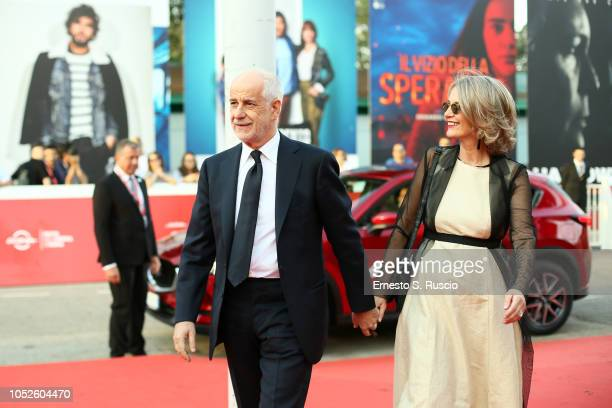 Toni Servillo and Manuela Lamanna walk a red carpet during the 13th Rome Film Fest at Auditorium Parco Della Musica on October 20, 2018 in Rome,...