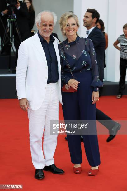 """Toni Servillo and Manuela Lamanna walk the red carpet ahead of the Opening Ceremony and the """"La Vérité"""" screening during the 76th Venice Film..."""