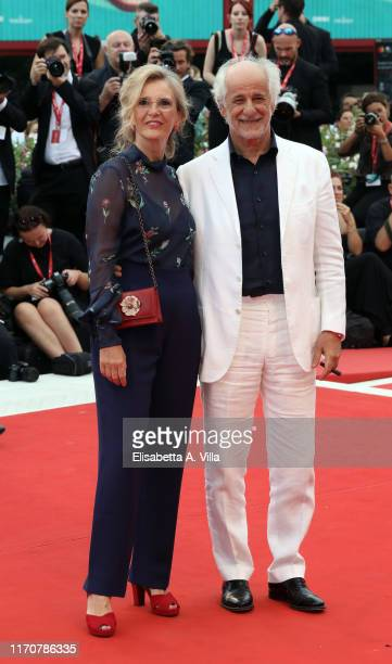 Toni Servillo and wife Manuela Lamanna walk the red carpet ahead of the opening ceremony during the 76th Venice Film Festival at Sala Casino on...