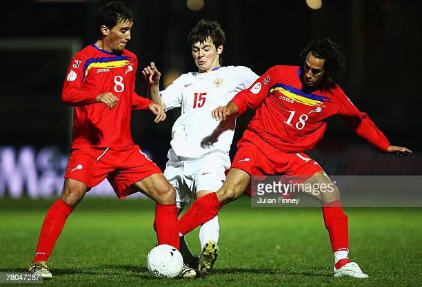 Toni Sivera and Xavi Andorra of Andorra challenge Diniyar Bilyaletdinov of Russia during the Euro2008 Qualifier match between Andorra and Russia at...