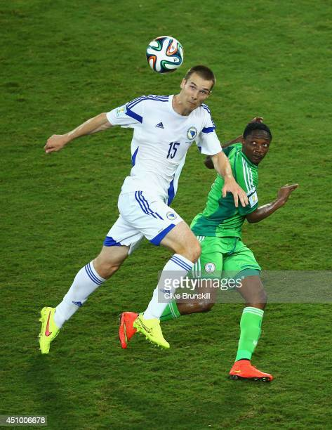 Toni Sunjic of Bosnia and Herzegovina controls the ball against Ahmed Musa of Nigeria during the 2014 FIFA World Cup Group F match between Nigeria...