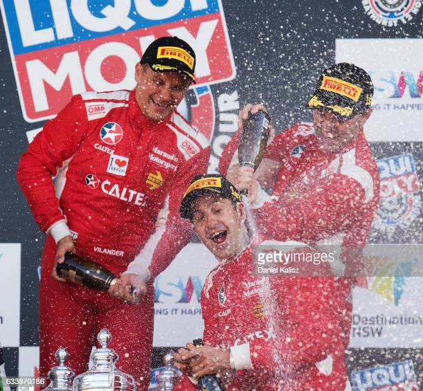 Toni Vilander Craig Lowndes and Jamie Whincup drivers of the Maranello Motorsport Ferrari celebrate on the podium after winning the 2017 Bathurst 12...