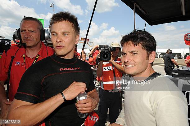 Toni Vilander of Finland celebrates with codriver Giancarlo Fisichella of Italy after capturing the GT class pole position driving the Risi...