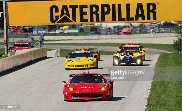 Toni Vilander of Finland drivers the Risi Competizione Ferrari 458 Italia during the American Le Mans Series Time Warner Cable Road Race Showcase at...