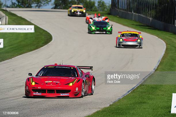 Toni Vilander of Finland drives the Risi Competizione Ferrari 458 Italia during the American Le Mans Series Time Warner Cable Road Race Showcase at...