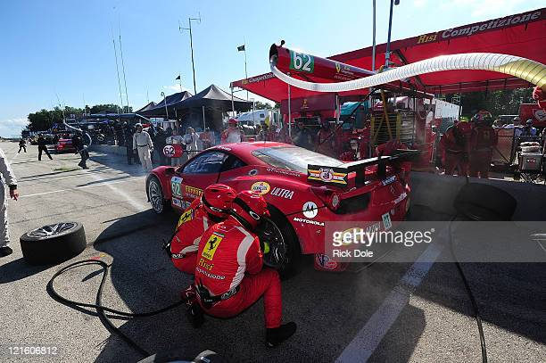 Toni Vilander of Finland in for a pit stop in the Risi Competizione Ferrari 458 Italia during the American Le Mans Series Time Warner Cable Road Race...