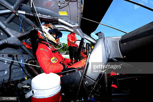 Toni Vilander of Finland sits in the cockpit of the Risi Competizione Ferrari 458 Italia during qualifying for the American Le Mans Series Time...