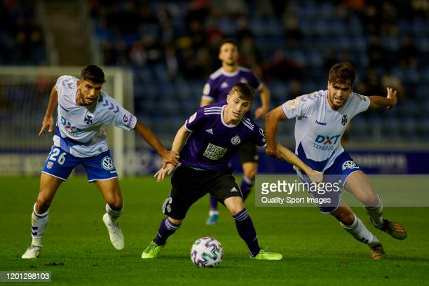 Toni Villa of Valladolid competes for the ball with Javier Alonso and Iker Undabarrena of Tenerife during the match between Tenerife and Valladolidad...