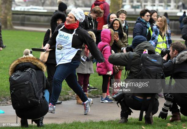Tonia Antoniazzi MP and team captain approaches the second corner in the annual Parliamentary Pancake Race in Victoria Tower Gardens on Shrove...