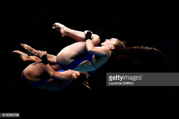 Tonia Couch and Lois Toulson of Great Britain compete during the Women's Diving 10M Synchro Platform preliminary round on day three of the Budapest...