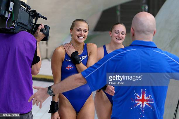 Tonia Couch and Sarah Barrow of Great Britain react with their coach Andy Banks after finishing second in the Women's 10m Synchro Platform Final...