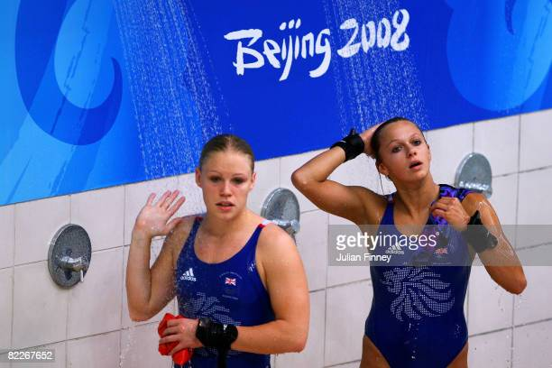 Tonia Couch and Stacie Powell of Great Britain shower in the Women's Synchronised 10m Platform Final held at the National Aquatics Center during day...