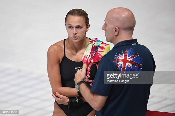 Tonia Couch of Great Britain speaks with her coach Andy Banks during the Women's 10m Platform Diving Final on day six of the 16th FINA World...