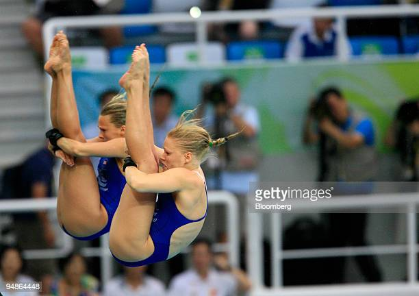 Tonia Couch right and Stacie Powell of Great Britain hold a pike position in the women's 10meter synchronized diving event during day four of the...