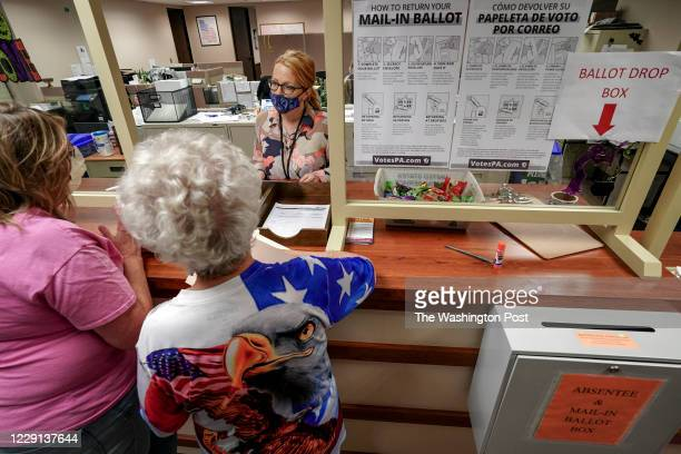 Tonia Fernandez, supervisor of elections, works with citizens in Erie, Pennsylvania, on October 15, 2020. Erie County is a battleground county and...