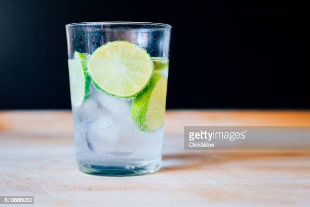 Tonic water glass with slices of limes