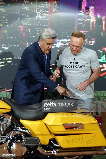 """Tonight Show"""" host Jay Leno and actor James Caan appear onstage to sign a Harley-Davidson motorcycle that Leno is using to raise money for the..."""