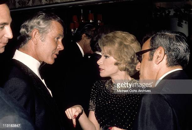 Tonight Show host Johnny Carson greets comedienne Joan Rivers and her Husband Edgar Rosenberg at the party after taping the 10th anniversary show on...