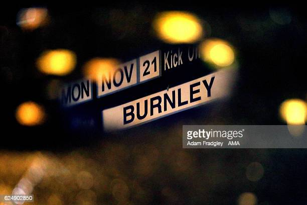 Tonights fixture board reflected in a rain puddle prior to the Premier League match between West Bromwich Albion and Burnley at The Hawthorns on...