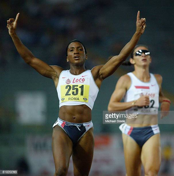 Tonique Williams of Bahamas celebrates winning the womens 400m during at the IAAF Golden Gala meet at the Olympic stadium on July 2 2004 in Rome Italy