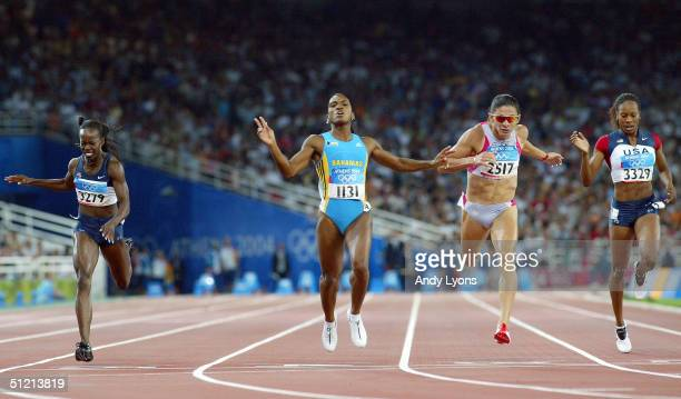 Tonique WilliamsDarling of Bahamas crosses the finish line as she win's gold in the women's 400 metre final on August 24 2004 during the Athens 2004...