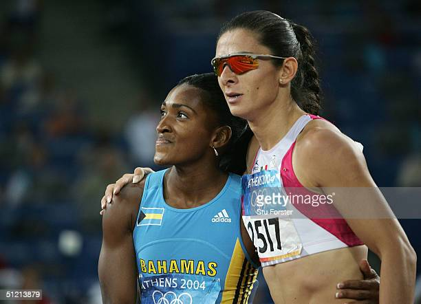 Tonique WilliamsDarling of Bahamas is embraced by Ana Guevara of Mexico after she won the women's 400 metre final on August 24 2004 during the Athens...