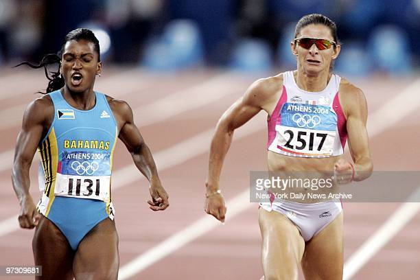Tonique WilliamsDarling of the Bahamas and Ana Guevara of Mexico battle it out in the women's 400meter race at the 2004 Summer Olympic Games in...