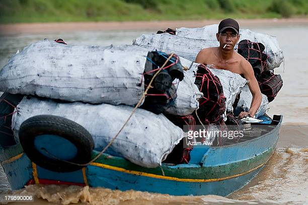 Tonlé Sap River, Siem Reap Cambodia-May 5, 2011:Traders bring charcoal for the villagers.