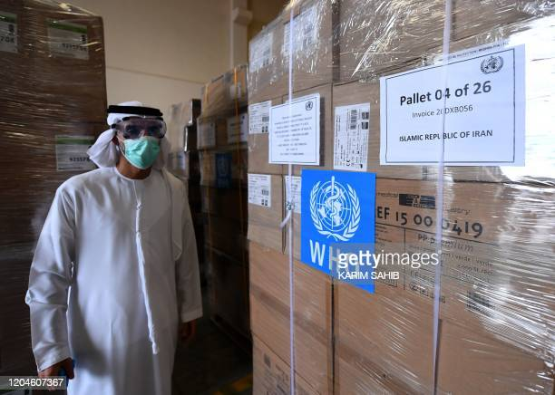 Tonnes of medical equipment and coronavirus testing kits provided bt the World Health Organisation are pictured at the alMaktum International airport...