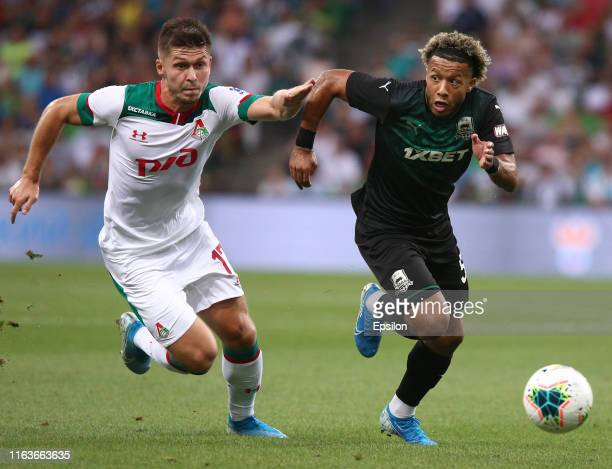 Tonny Vilhena of FC Krasnodar vies for the ball with Rifat Zhemaletdinov of FC Lokomotiv Moscow during the Russian Premier League match between FC...