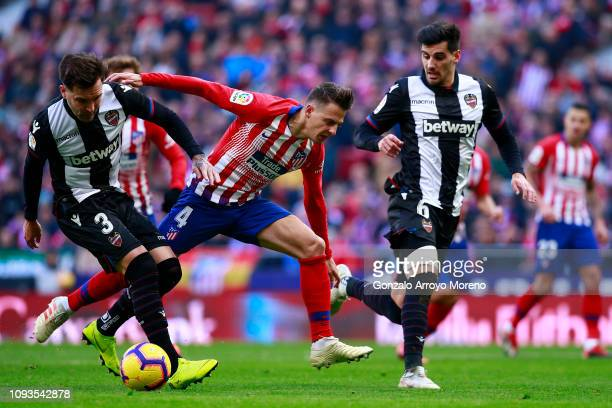 Tono Garcia of Levante battles for possession with Santiago Arias of Atletico Madrid during the La Liga match between Club Atletico de Madrid and...