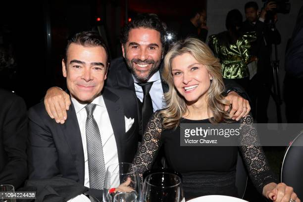 Tono Mauri and his wife Carla Aleman pose for photos with Pepe Baston during the amfAR gala dinner at the house of collector and museum patron...