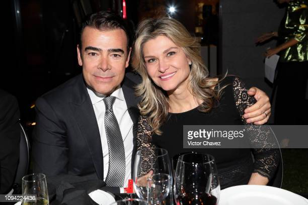Tono Mauri poses alongside his wife Carla Aleman during the amfAR gala dinner at the house of collector and museum patron Eugenio López on February 5...