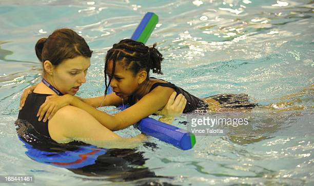 VT Tons of Star kids learning to swim today at malvern pool Location Malvern Collegiate pool City YMCA instructor Suzie Lowe helps Gelila 10 yrs...