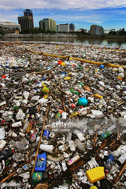 Tons of trash is held back from entering into Long Beach Harbor after washing down from the Los Angeles area with a recent rain A crane was brought...