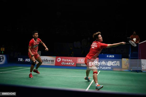 Tontowi Ahmad and Liliyana Natsir of Indonesia compete against Chan Peng Soon and Yen Wei Peck of Malaysia during Mixed Double Semifinal match of the...
