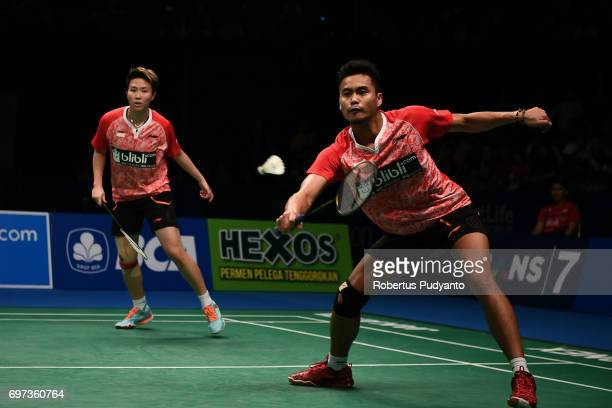 Tontowi Ahmad and Liliyana Natsir of Indonesia compete against Zheng Siwei and Chen Qingchen of China during Mixed Double Final match of the BCA...