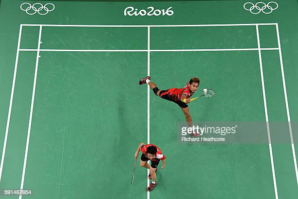 Tontowi Ahmad and Liliyana Natsir of Indonesia compete during the Mixed Doubles Gold Medal Match against Peng Soon Chan and Liu Ying Goh of Malaysia...