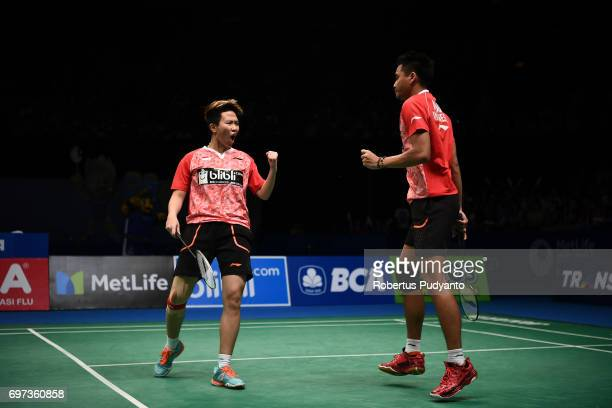 Tontowi Ahmad and Liliyana Natsir of Indonesia react against Zheng Siwei and Chen Qingchen of China during Mixed Double Final match of the BCA...