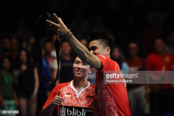Tontowi Ahmad and Liliyana Natsir of Indonesia take a wefie photo after beating Zheng Siwei and Chen Qingchen of China during Mixed Double Final...