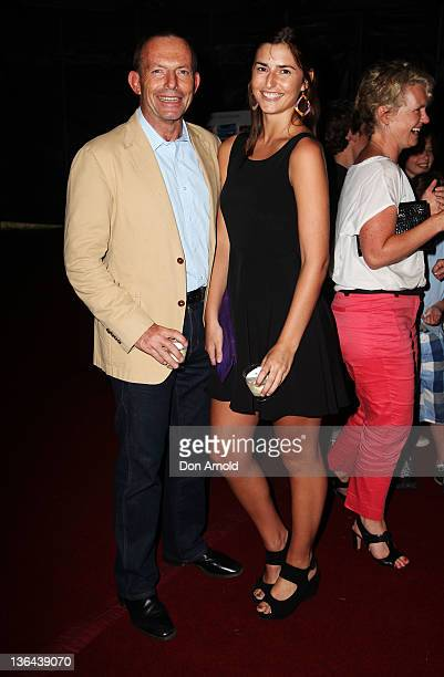 Tony Abbott and daughter Frances Abbott pose at the Circus Oz Sydney launch at Darling Harbour on January 5 2012 in Sydney Australia