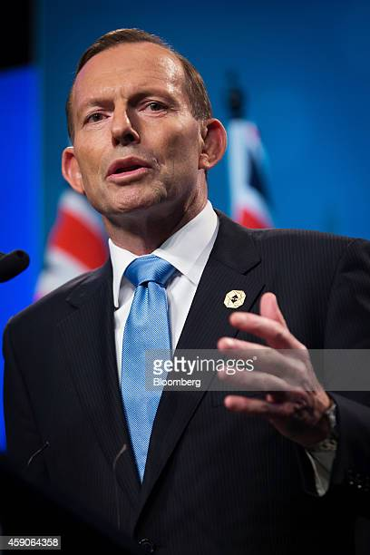 Tony Abbott Australia's prime minister gestures as he speaks during a news conference at the Group of 20 summit in Brisbane Australia on Sunday Nov...
