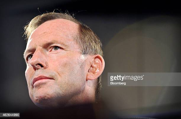 Tony Abbott Australia's prime minister is seen behind a lectern while giving a speech at the National Press Club in Canberra Australia on Monday Feb...