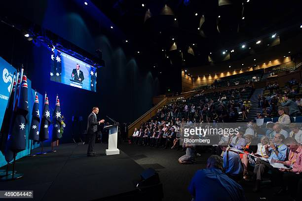 Tony Abbott Australia's prime minister left gestures as he speaks during a news conference at the Group of 20 summit in Brisbane Australia on Sunday...