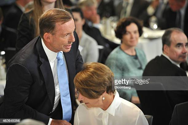 Tony Abbott Australia's prime minister left rises from his seat before speaking at the National Press Club in Canberra Australia on Monday Feb 2 2015...