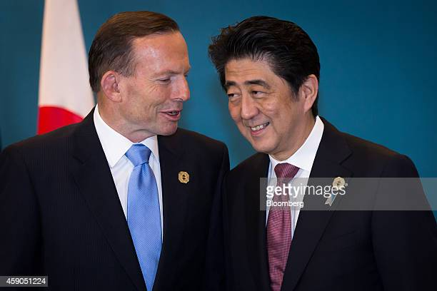 Tony Abbott Australia's prime minister left speaks with Shinzo Abe Japan's prime minister during a trilateral meeting at the Group of 20 summit in...